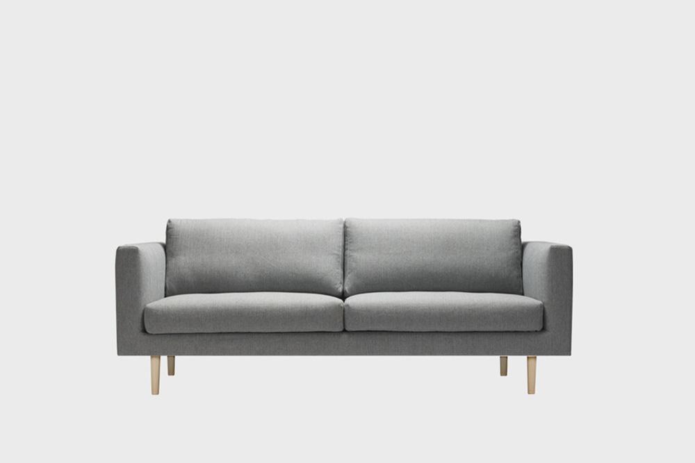 Cosy-sohvan irtopäällinen tummanharmaalla Florist-kankaalla.