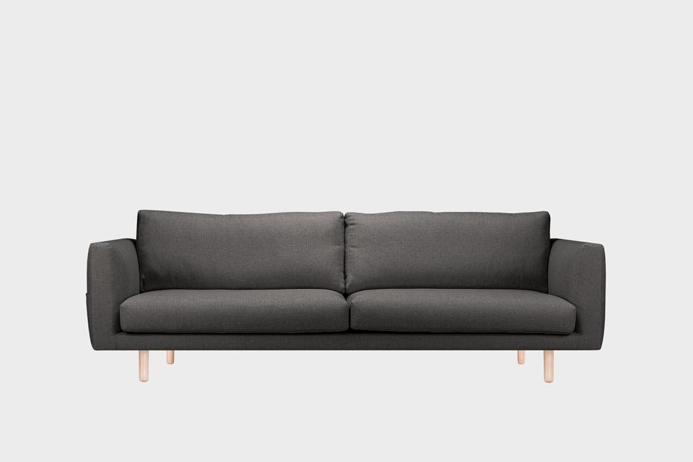 Iso Cosy Pocket -sohva tummanharmaalla Florist-kankaalla ja koivujalalla.