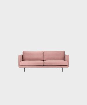 Pieni Lazy-sohva vaaleanpunaisella Soft-kankaalla ja metallijalalla.