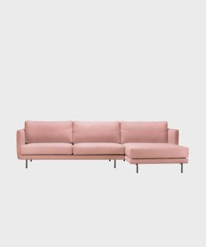 Oikeakätinen Lazy-divaani vaalaenpunaisella Soft-kankaalla ja metallijalalla.